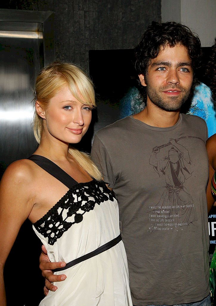 "Image Credits: Getty Images / Michael Tran / FilmMagic | Socialite Paris Hilton and Actor Adrian Grenier arrives at the ""11th Hour"" Screening at Harmony Gold Theater on August 9, 2007 in Hollywood, California."