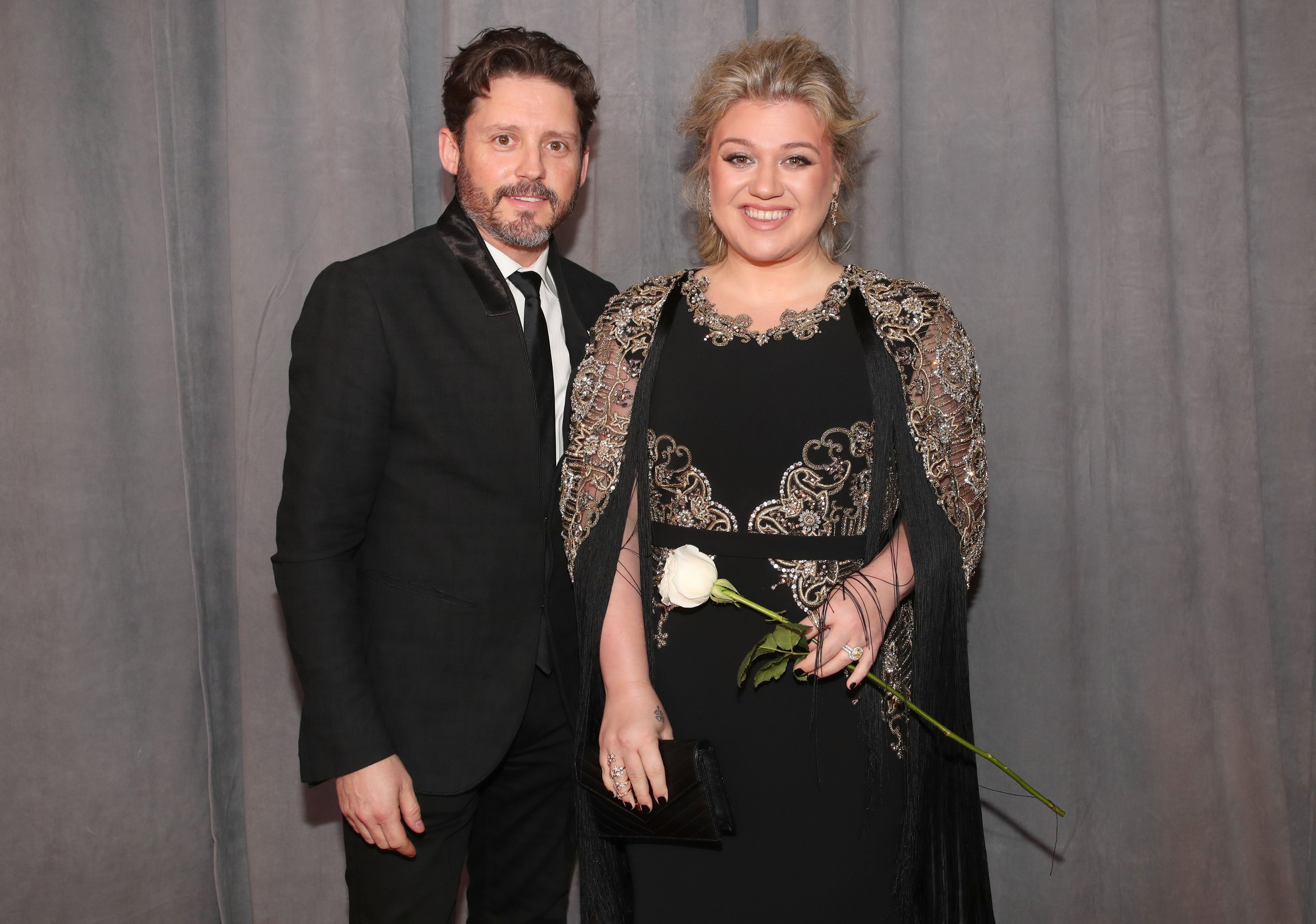 Nobody knows if Kelly's divorce will have any influence on Blake and Brandon's collaboration / Getty Images