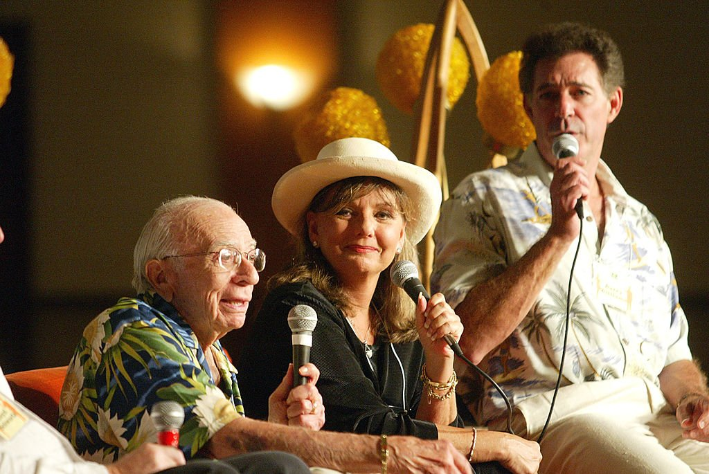 "Image Source: Getty Images/Kevin Winter/Producer Sherwood Schwartz, ""Gilligans Island"" actress Dawn Wells and ""Brady Bunch"" actor Barry Williams appear at the First Official TV Land Convention at the Burbank Airport Hilton on August 16, 2003 in Burbank, California"