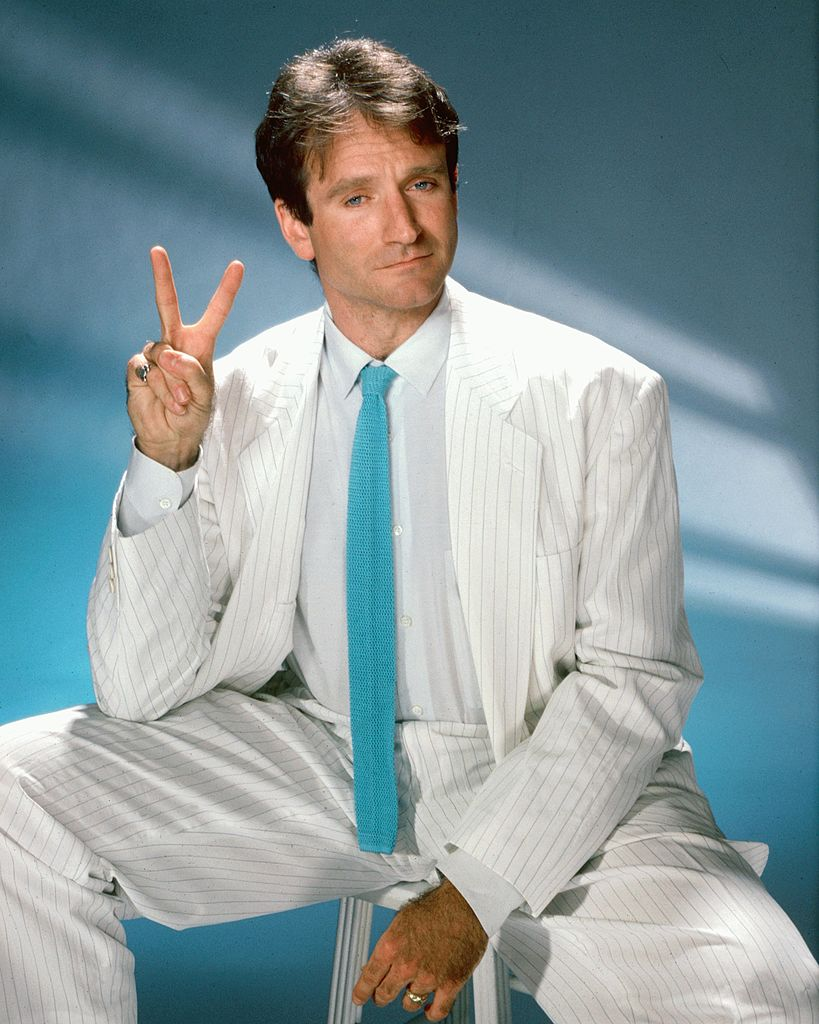 Image Credits: Getty Images / Harry Langdon | Actor and comedian Robin Williams poses for a portrait circa 1999 in Los Angeles, California.