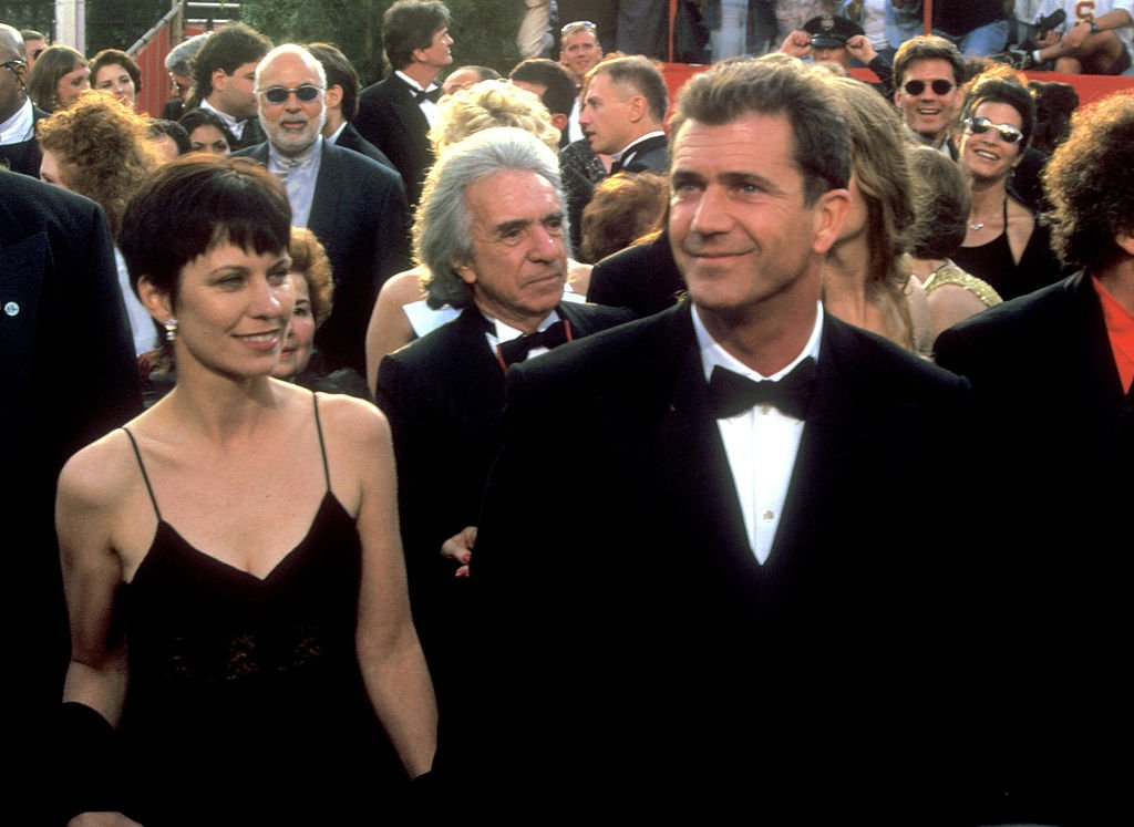 Image Credit: Getty Images / Mel Gibson (right) and wife Robyn arrive at The 69th Annual Academy Awards.