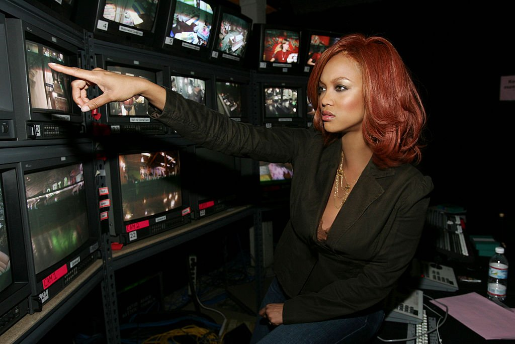 Image Credit: Getty Images / Tyra Banks, creator and executive producer, at the monitors of AMERICA'S NEXT TOP MODEL on UPN.