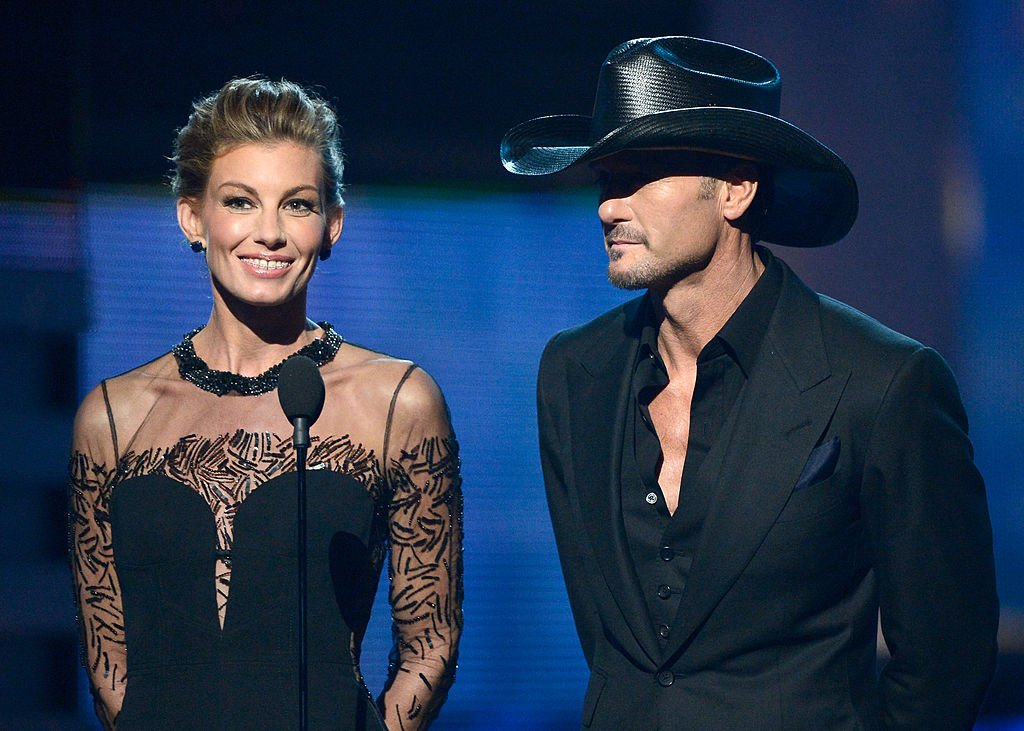 Image Credits: Getty Images / Kevork Djansezian | Singers Faith Hill and Tim McGraw speak onstage at the 55th Annual GRAMMY Awards at Staples Center on February 10, 2013 in Los Angeles, California.
