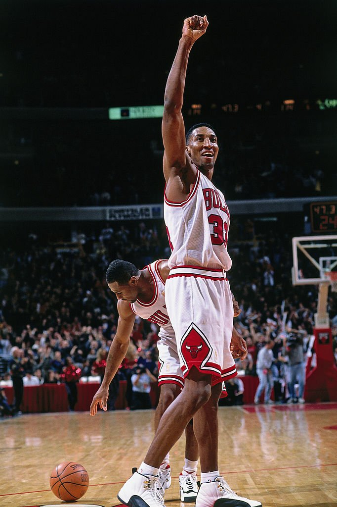 Image Credits: Getty Images / Andrew D. Bernstein / NBAE | Scottie Pippen #33 of the Chicago Bulls celebrates against the Los Angeles Lakers on December 17, 1996 at the United Center in Chicago, Illinois.