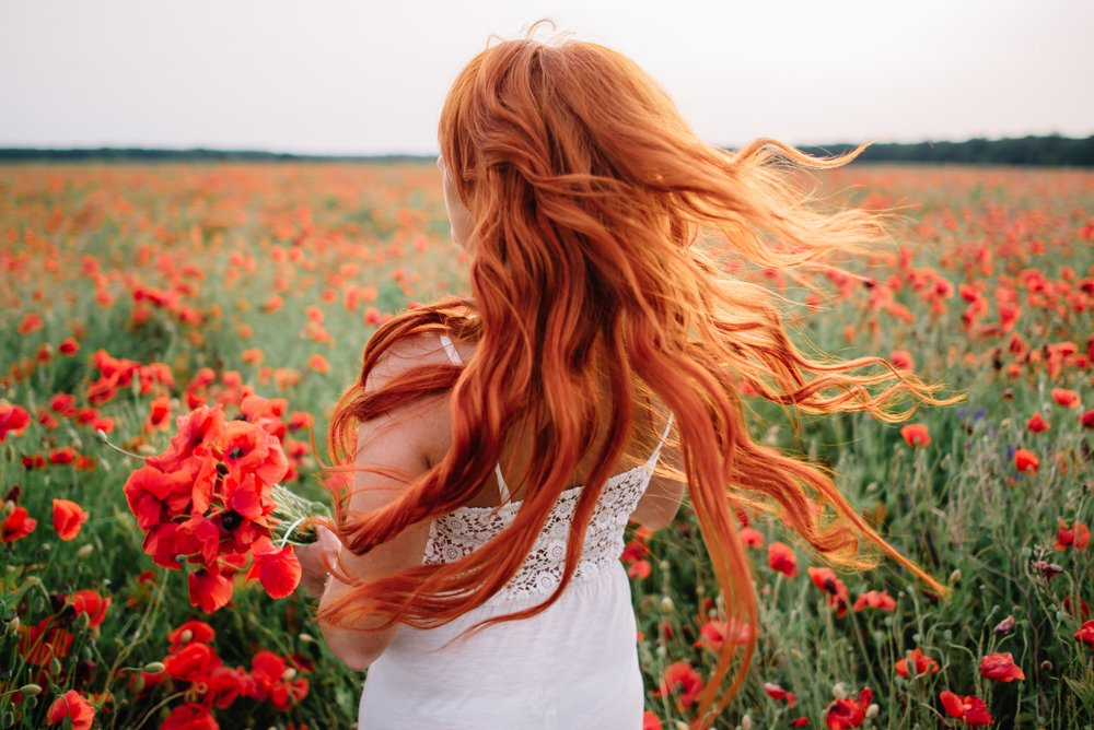 Red haired woman | Shutterstock