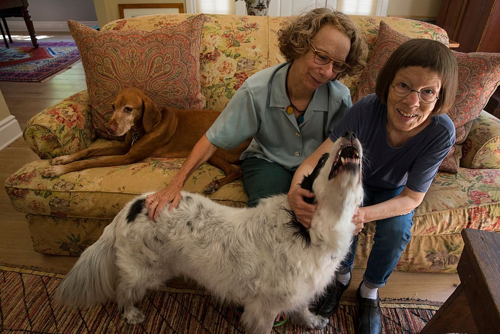 Image Credit: Getty Images / Actress and Oscar winner, Linda Hunt poses with her wife, Linda and their pets.