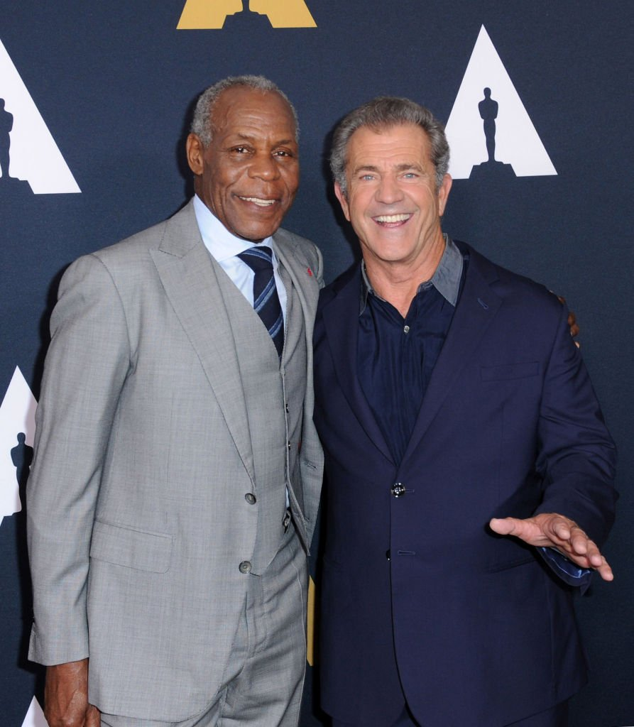 Image Source: Getty Images/Joshua Blanchard| Danny Glover (L) and Mel Gibson arrive at The Academy Celebrates Filmmaker Richard Donner at Samuel Goldwyn Theater on June 7, 2017 in Beverly Hills, California
