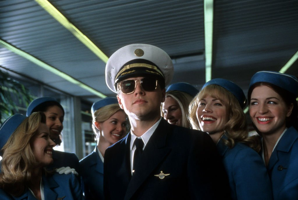 Image Source: Getty Images/Archive Photos| Leonardo DiCaprio with airline stewardess surrounding him in a scene from the film 'Catch Me If You Can', 2002