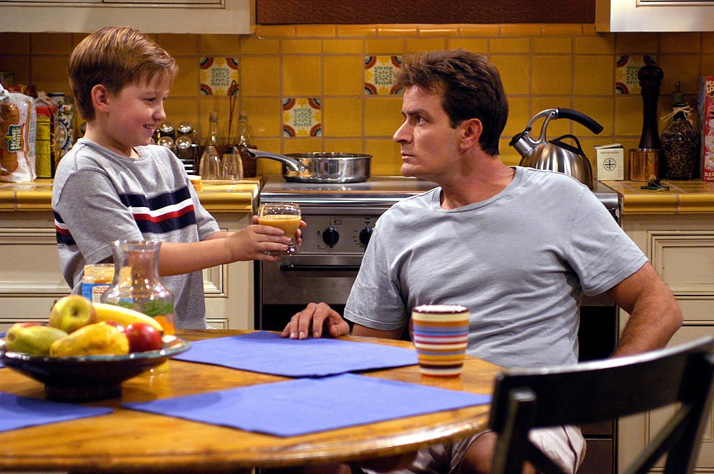 Image Credit: Getty Images / Actors Charlie Sheen and August T. Jones on set for the series Two and A Half Men.