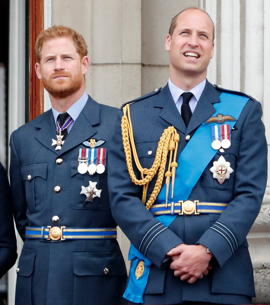Image Credits: Getty Images / Max Mumby / Indigo   Prince Harry, Duke of Sussex and Prince William, Duke of Cambridge watch a flypast to mark the centenary of the Royal Air Force from the balcony of Buckingham Palace on July 10, 2018 in London, England. The 100th birthday of the RAF, which was founded on on 1 April 1918, was marked with a centenary parade with the presentation of a new Queen's Colour and flypast of 100 aircraft over Buckingham Palace.