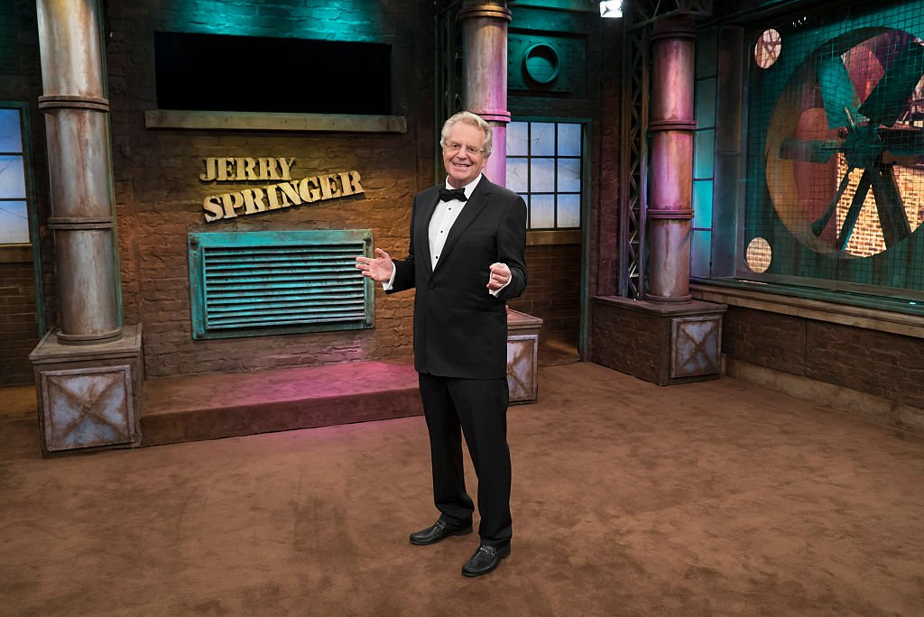 Image Source: Getty Images/NBCU Photo Bank/NBCUniversal via Getty Images/Virginia Sherwood | Jerry Springer on set
