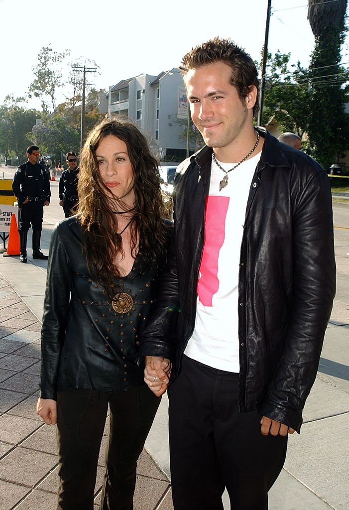 Image Source: Getty Images/Jeff Kravitz | Alanis Morissette and Ryan Reynolds during 2003 MTV Movie Awards