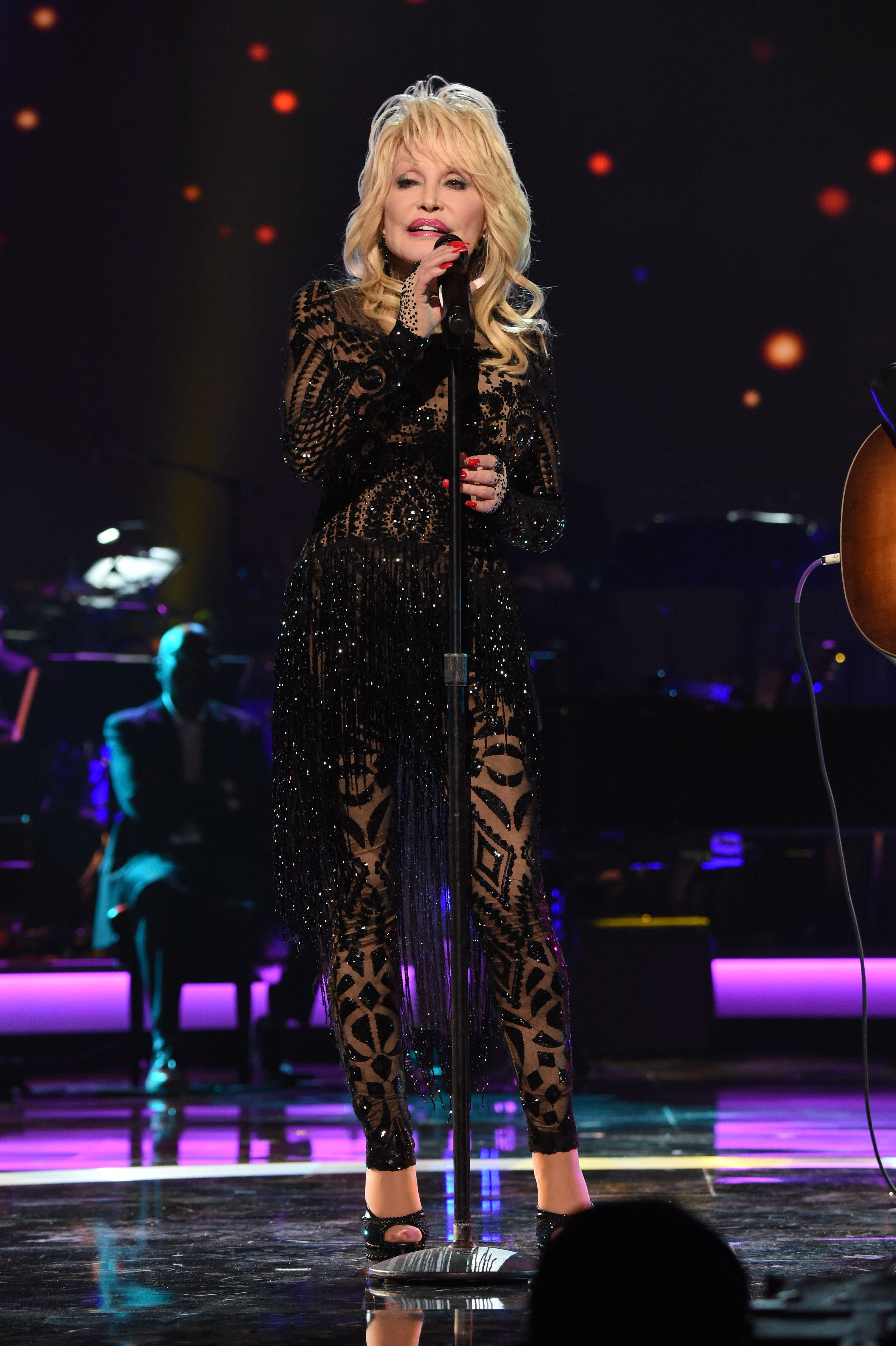 Image Credits: Getty Images / Kevin Mazur | Dolly Parton performs onstage MusiCares Person of the Year honoring Dolly Parton at Los Angeles Convention Center on February 8, 2019 in Los Angeles, California.