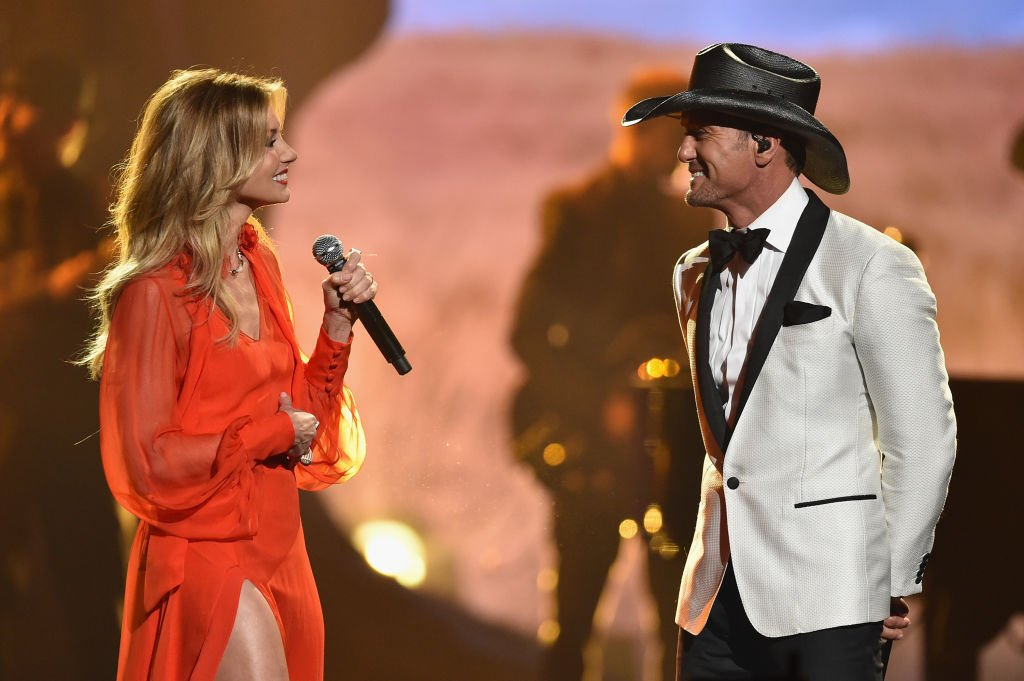 Image Credits: Getty Images / John Shearer / WireImage | Faith Hill and Tim McGraw perform onstage at the 51st annual CMA Awards at the Bridgestone Arena on November 8, 2017 in Nashville, Tennessee.
