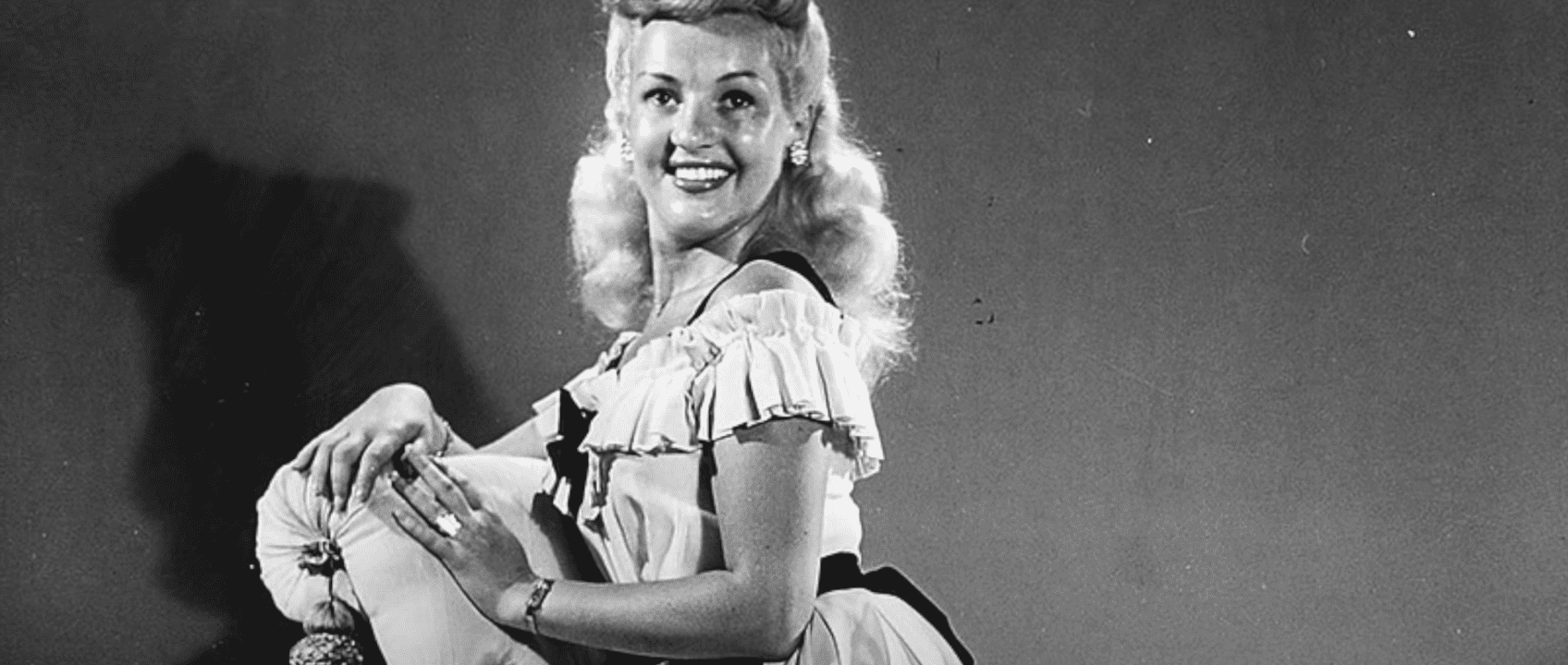 Image Source: Youtube/Mo10ta| Betty smiling for the camera