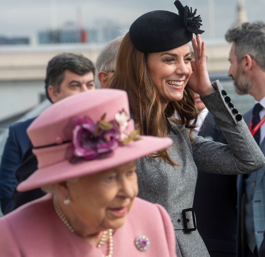 Image Credit: Getty Images / Queen Elizabeth II and Catherine, Duchess of Cambridge visit King's College on March 19, 2019 in London, England.