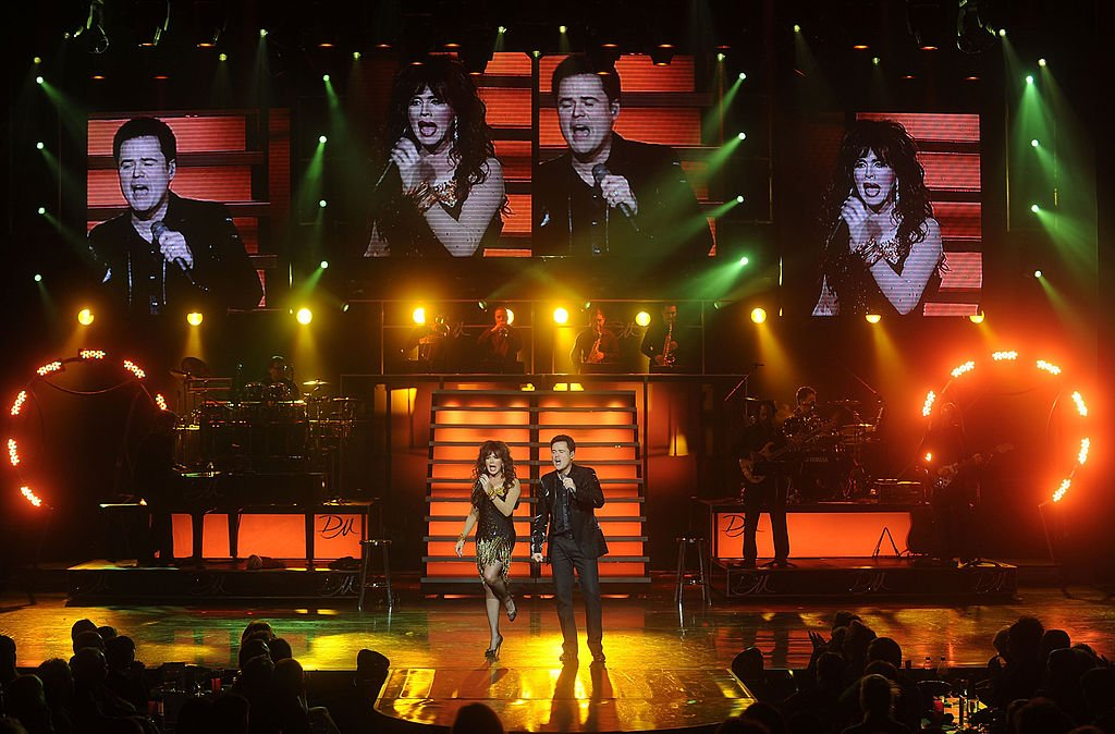 Image Credit: Getty Images / Marie Osmond and Donny Osmond perform at the Donny and Marie Show on December 3, 2008 in Las Vegas, Nevada.