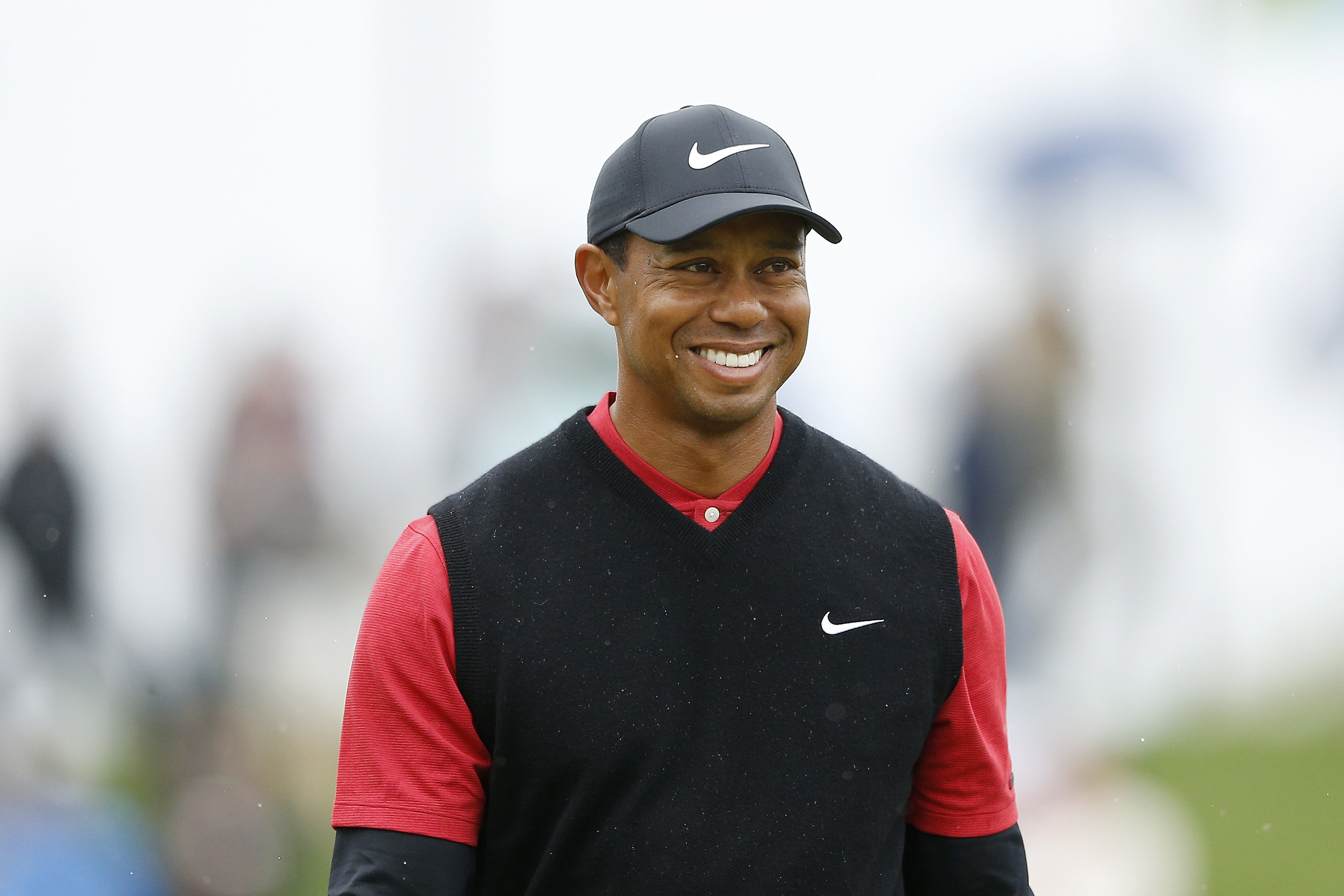 Image Credits: Getty Images / Michael Reaves | Tiger Woods of the United States reacts after chipping in from the bunker on the third hole during the final round of The PLAYERS Championship on The Stadium Course at TPC Sawgrass on March 17, 2019 in Ponte Vedra Beach, Florida.