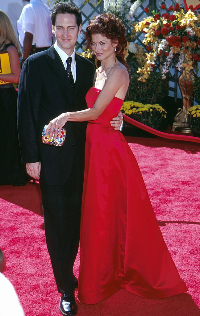 Image Source: Getty Images/Scott Gries| Debra Messing ('Will and Grace') in Vera Wang with her husband Daniel Zelman at the 2000 Emmy Awards on September 10, 2000 held in Los Angeles, CA