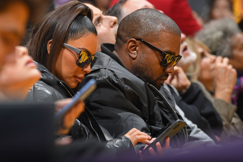 Image Credit: Getty Images / Kim Kardashian and Kanye West attend a basketball game between the Los Angeles Lakers and the Cleveland Cavaliers.