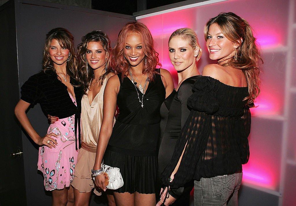Image Credit: Getty Images / Models Adriana Lima, Alessandra Ambrosio, Tyra Banks, Heidi Klum and Gisele Bundchen pose for a photo as they arrive for the Victoria Secrets Party at Geisha November 12, 2004 in Los Angeles.