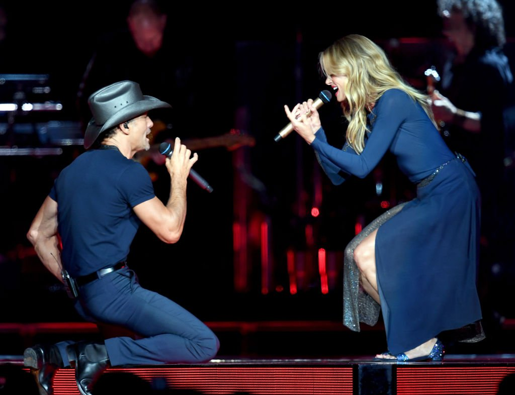 "Image Credits: Getty Images / Kevin Winter | Tim McGraw (L) and Faith Hill perform onstage during the ""Soul2Soul"" World Tour at Staples Center on July 14, 2017 in Los Angeles, California."