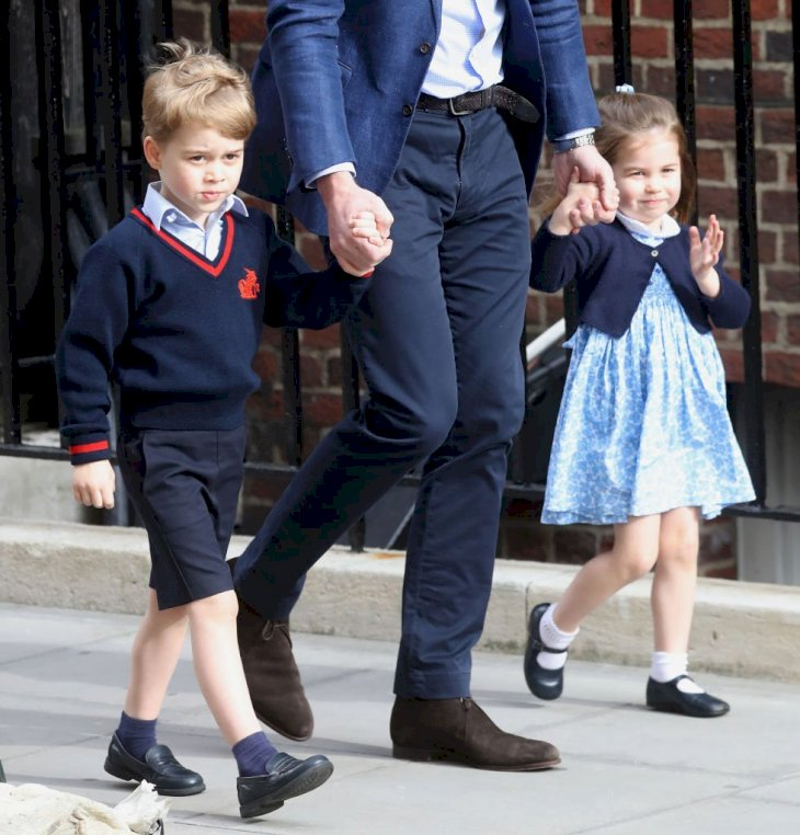 Image Credit: Getty Images / Prince William, Duke of Cambridge arrives with Prince George and Princess Charlotte at the Lindo Wing.