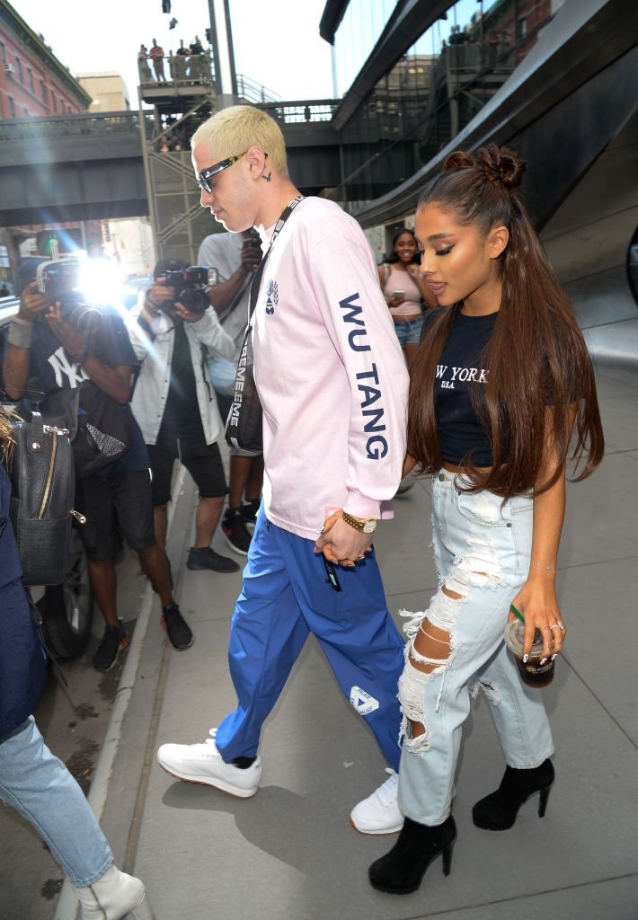 Image Source: Getty Images/Raymond Hall | Singer Ariana Grande (R) and Pete Davidson are seen walking in Midtown on July 11, 2018 in New York City