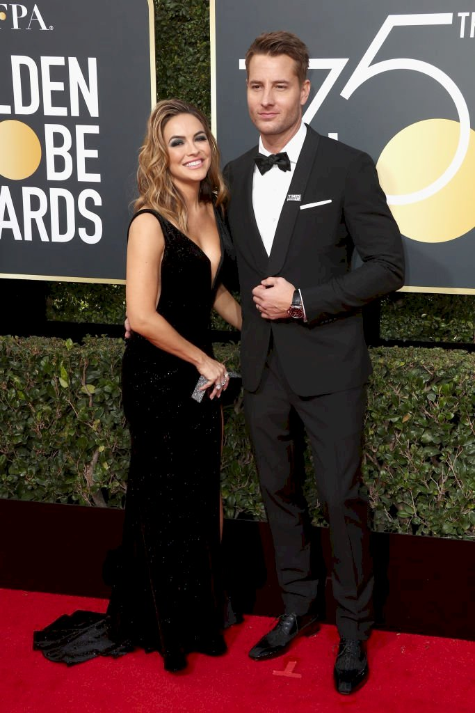 Image Credit: Getty Images / Actors, Chrishell Stause and Justin Hartley at an event.