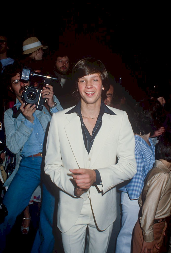Image Credit: Getty Images / Jimmy McNichol in a white 3 piece suit and black shirt; circa 1970.
