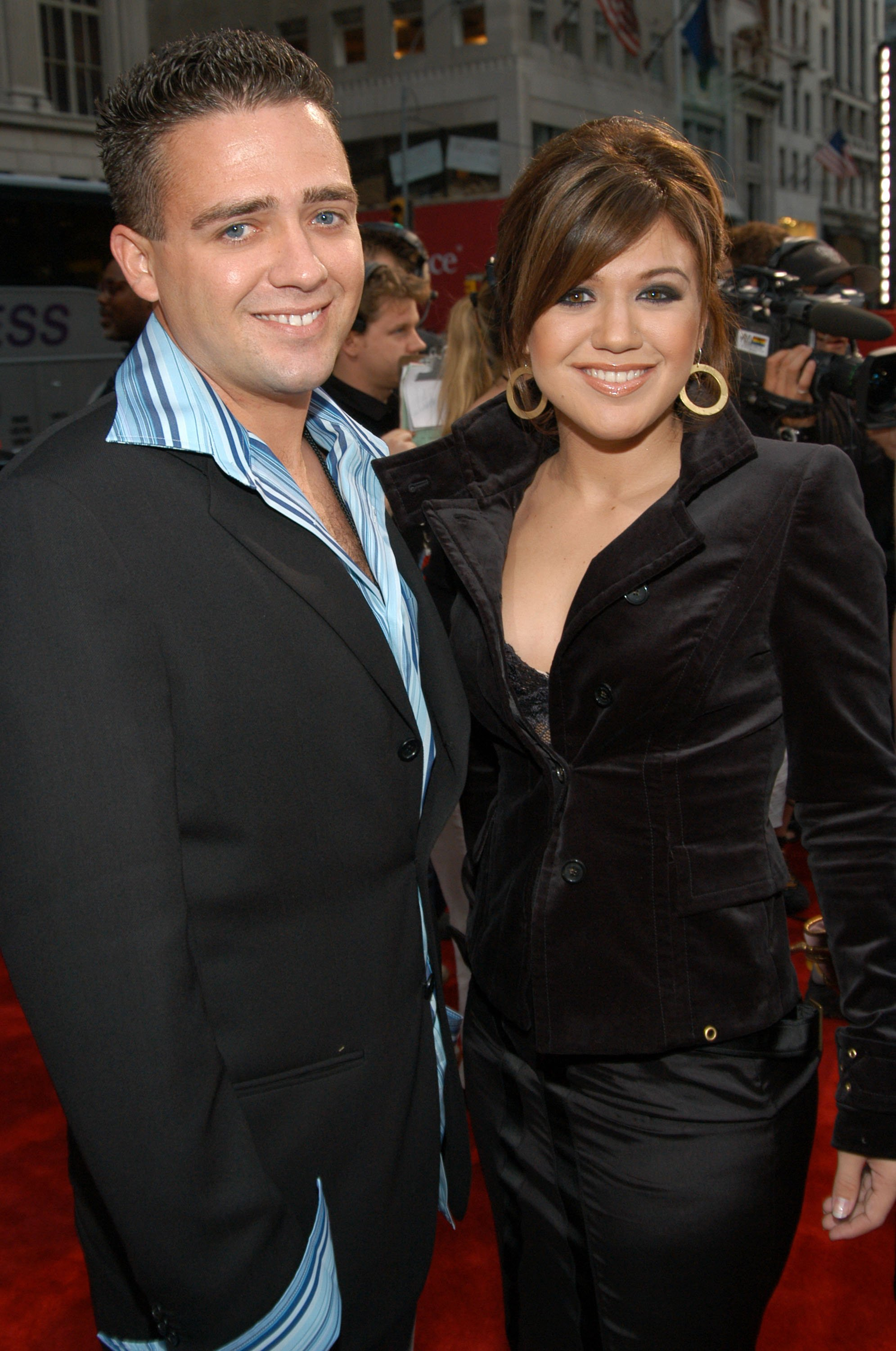 Image Credits: Getty Images | Kelly and her brother Jason at the Radio City Music Hall in New York City, 2003