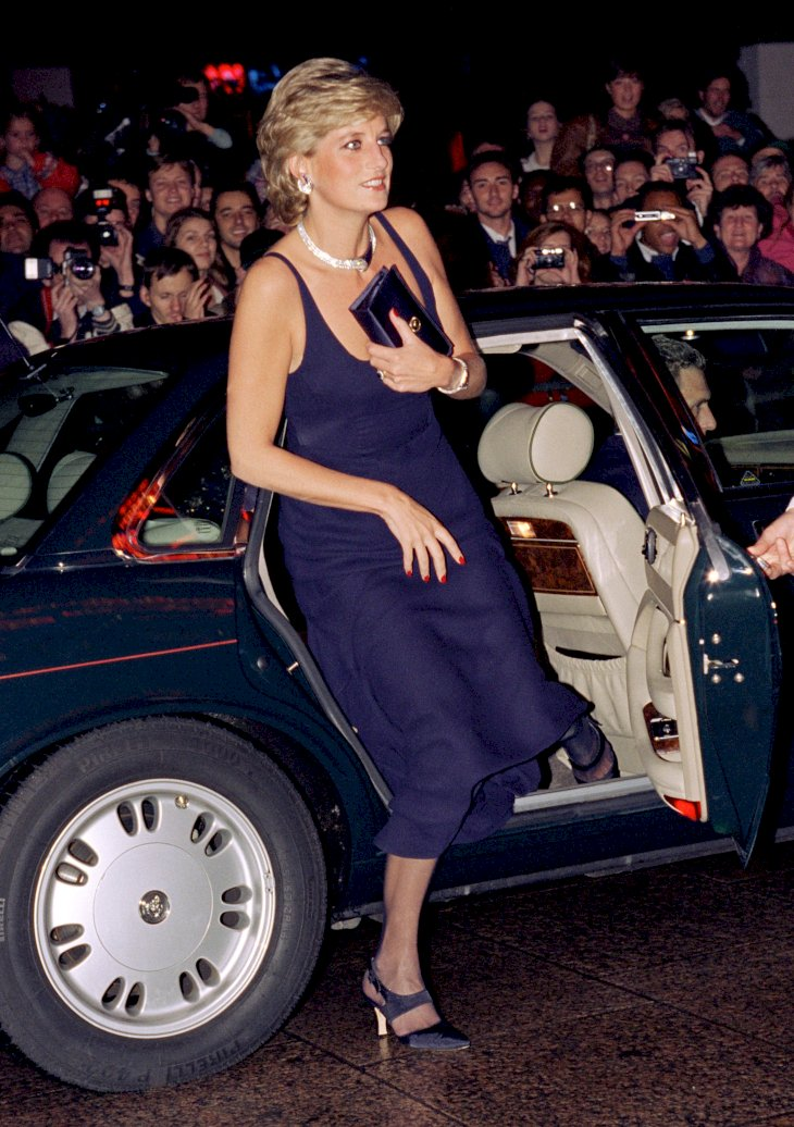 Image Credit: Getty Images / Princess Diana getting out of a car with her purse.