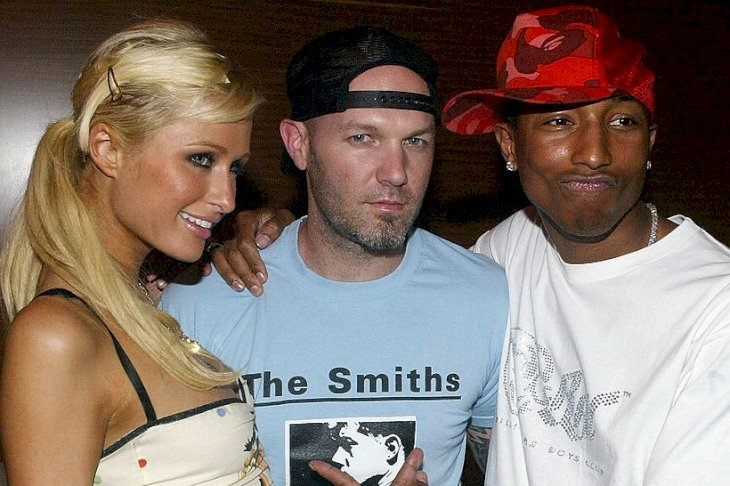 "Image Credits: Getty Images / Mark Mainz | Socialite Paris Hilton, musicians Fred Durst and Pharrell Williams attend the launch party for ""Reebok's Billionaire Boys Club Apparel line and Ice Cream Footwear Collection"" at Astra West on August 11, 2004 in Los Angeles, California."