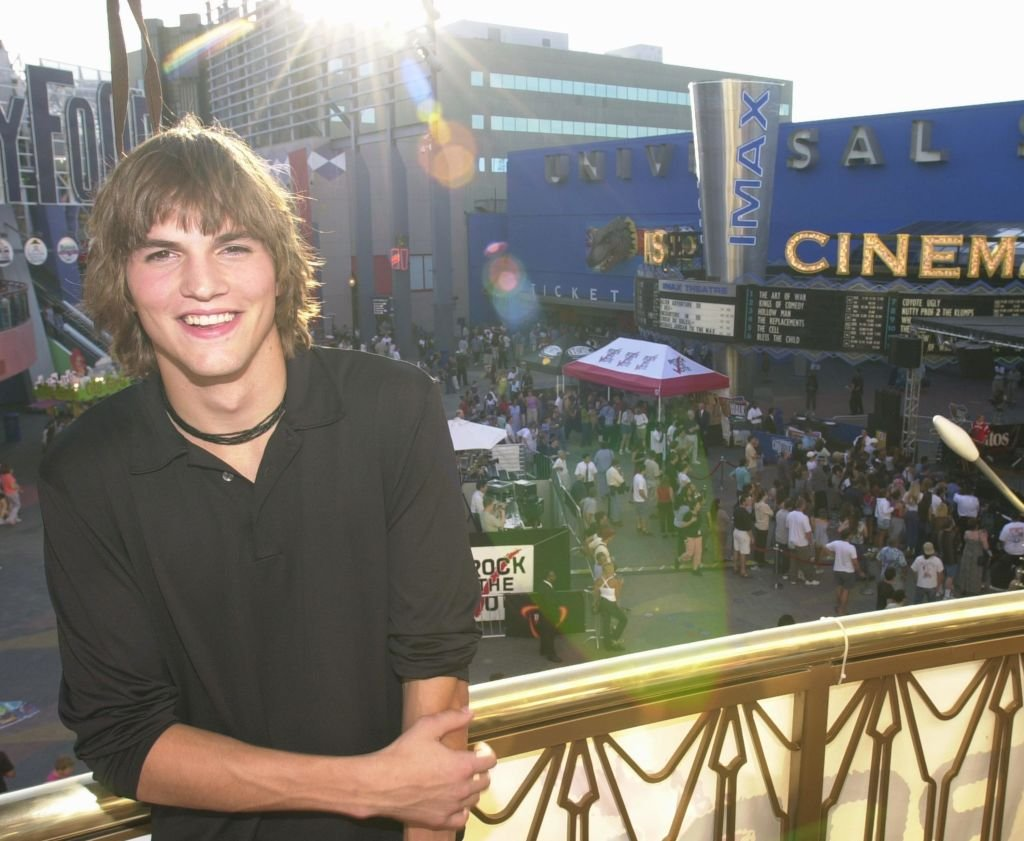 "Image Credit: Getty Images / Actor Ashton Kutcher of ""That 70's Show"" poses for a photographer August 26, 2000 at ""Rock the Vote"", part of the ""National Election 2000 Bus Tour"" at Universal City Walk in Universal City, CA."