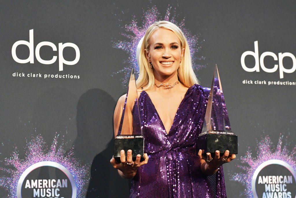 Carrie Underwood, winner of the Favorite Album - Country award for 'Cry Pretty' and Favorite Female Artist - Country award, poses in the press room during the 2019 American Music Awards at Microsoft Theater on November 24, 2019.