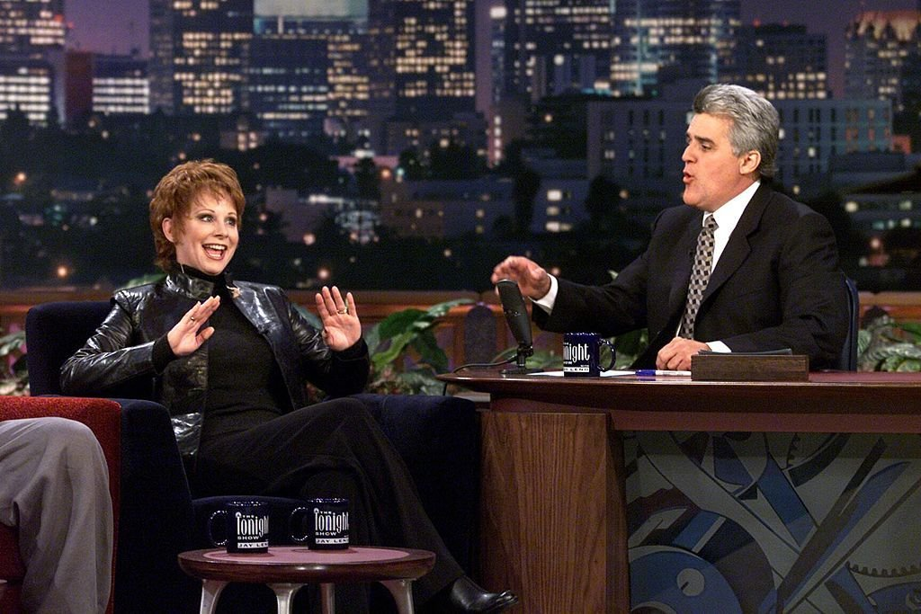 Image Credit: Getty Images / Acclaimed singer and actress, Reba McEntire on set with Jay Leno for his show.