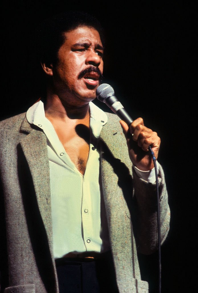Image Credits: Getty Images / Paul Natkin | Richard Pryor performing on stage