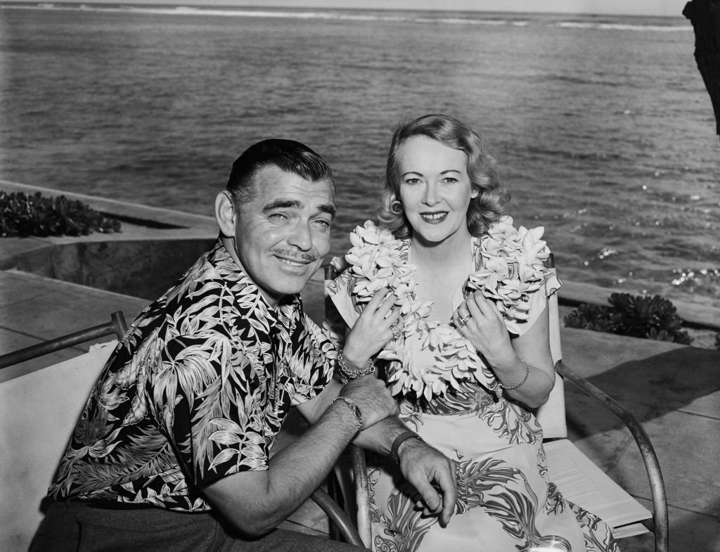 Image Credit: Getty Images / American actor Clark Gable with his wife, actress Sylvia Ashley during their honeymoon in Hawaii, 1950.