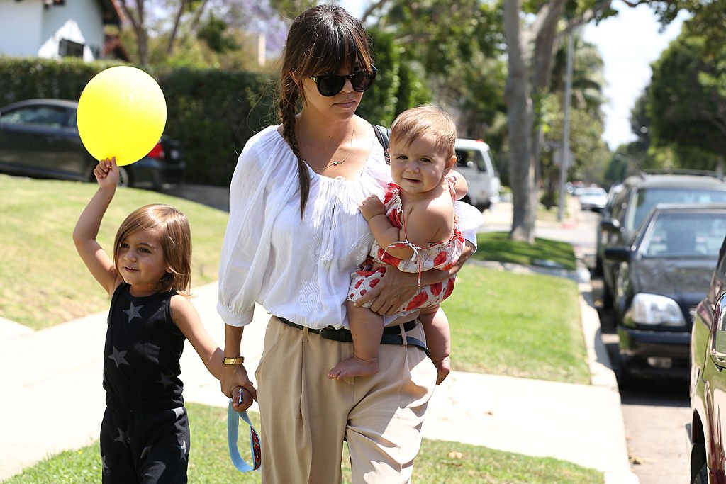 Image Credits: Getty Images / Bauer-Griffin / GC Images | Kourtney Kardashian with children Mason Disick and Penelope Disick are seen on June 08, 2013 in Los Angeles, California.