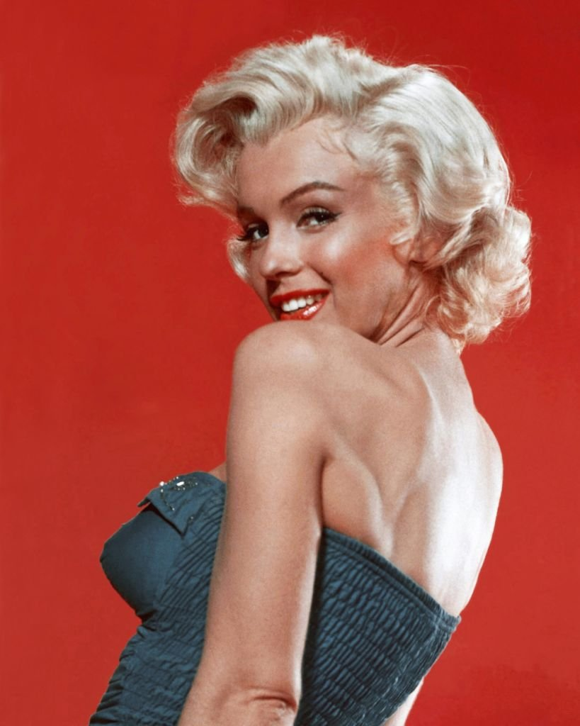 Image Source: Getty Images| Marilyn Monroe in a pin-up poster