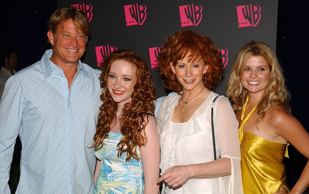 Image Credit: Getty Images / The WB Network's 2004 All Star Summer Party - Arrivals include Christopher Rich, Scarlett Pomers, Reba McEntire and JoAnna Garcia.