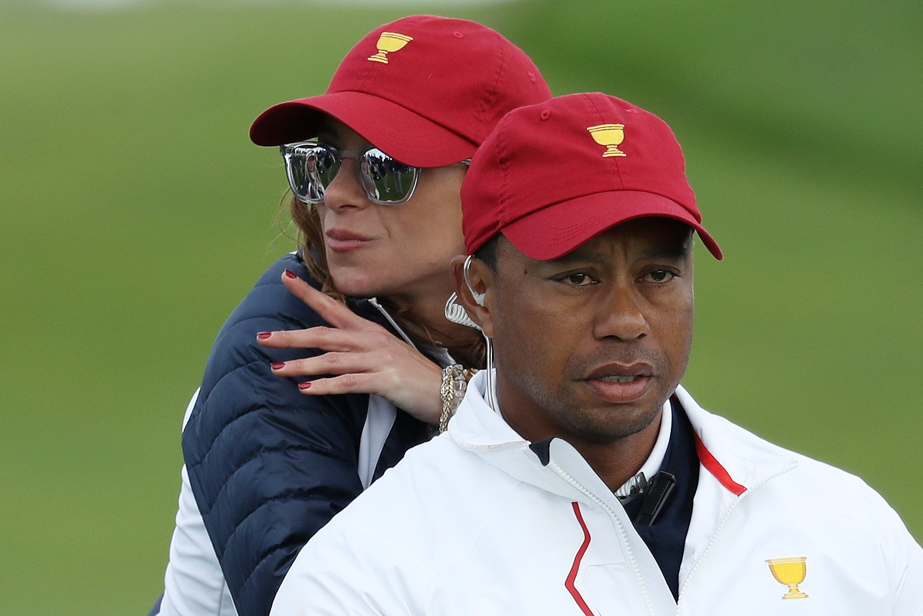 Image Credits: Getty Images /  Rob Carr | Captain's assistant Tiger Woods of the U.S. Team and Erica Herman lok on during Saturday four-ball matches of the Presidents Cup at Liberty National Golf Club on September 30, 2017 in Jersey City, New Jersey.