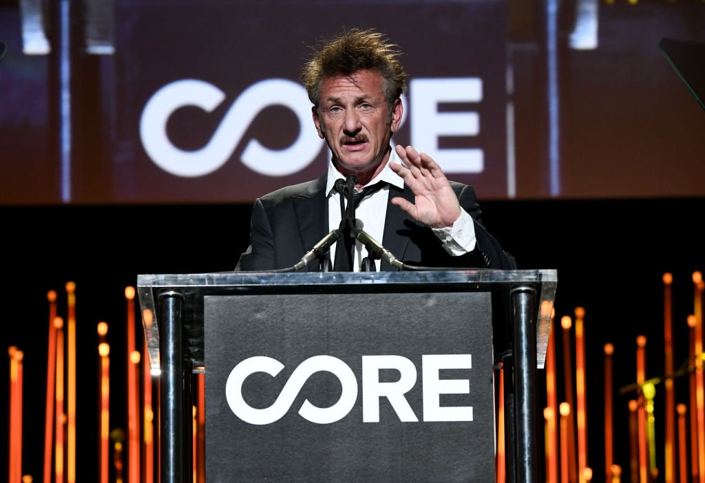 Image Credits: Getty Images / Michael Kovac | Sean Penn speaks onstage during CORE Gala: A Gala Dinner to Benefit CORE and 10 Years of Life-Saving Work Across Haiti & Around the World at Wiltern Theatre on January 15, 2020 in Los Angeles, California.