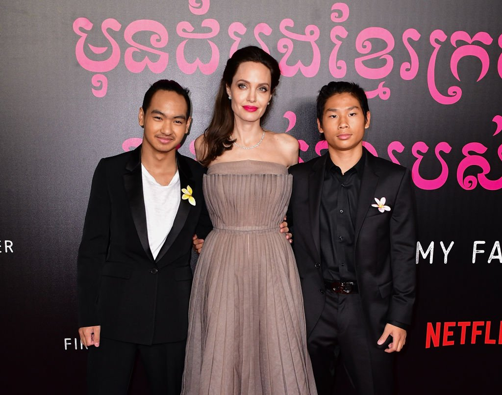 Image Source: Getty Images/James Devaney/Maddox Jolie-Pitt, Angelina Jolie and Pax Jolie-Pitt arrive to the DGA Theater for the New York premiere of 'First They Killed My Father' on September 14, 2017 in New York City