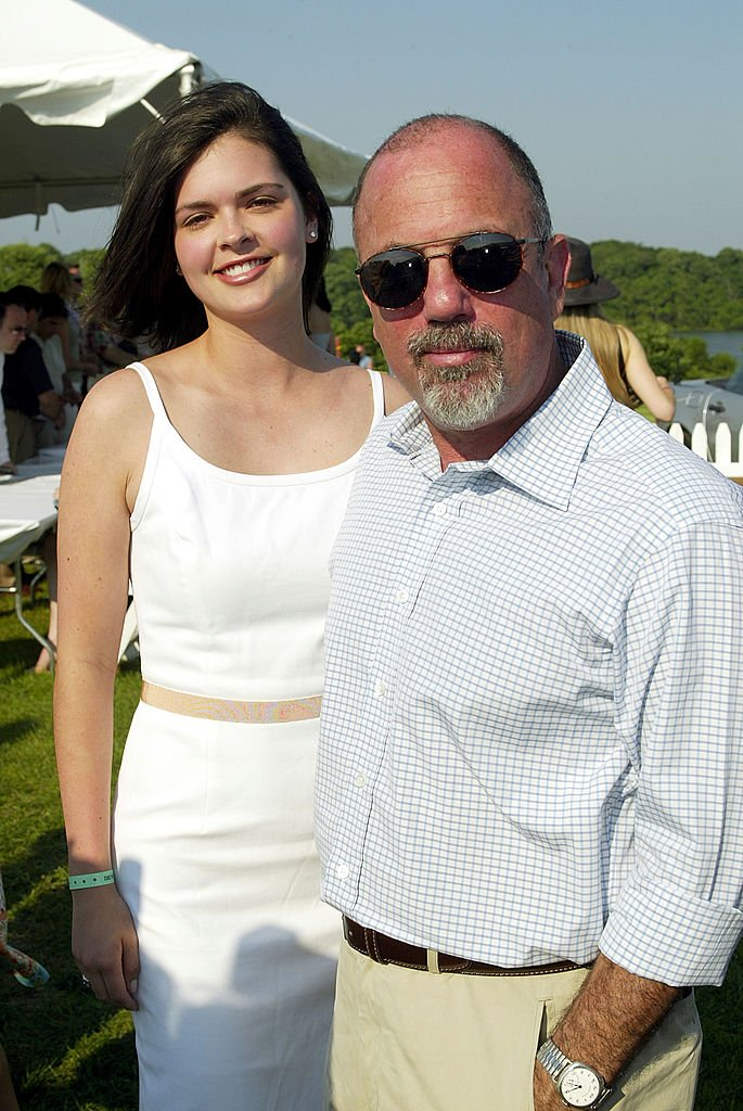 Image Credits: Getty Images / Scott Gries | Musician Billy Joel and his date Kate Lee pose for a photo at the 9th Annual Mercedes-Benz Polo Challenge to benefit The Retreat July 12, 2003 at the Bridgehampton Polo Club in Bridgehampton, New York.