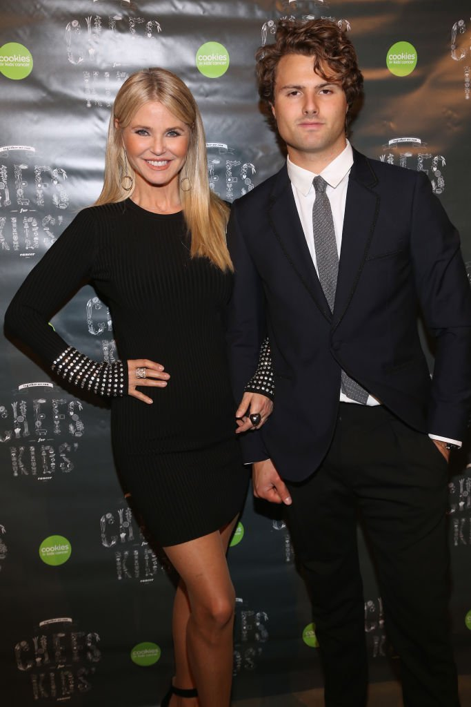 Image Credits: Getty Images / Sylvain Gaboury / Patrick McMullan | Christie Brinkley and Jack Brinkley-Cook attend Cookies for Kids' Cancer Fifth Annual Chefs Benefit at Metropolitan West on March 6, 2018 in New York City.