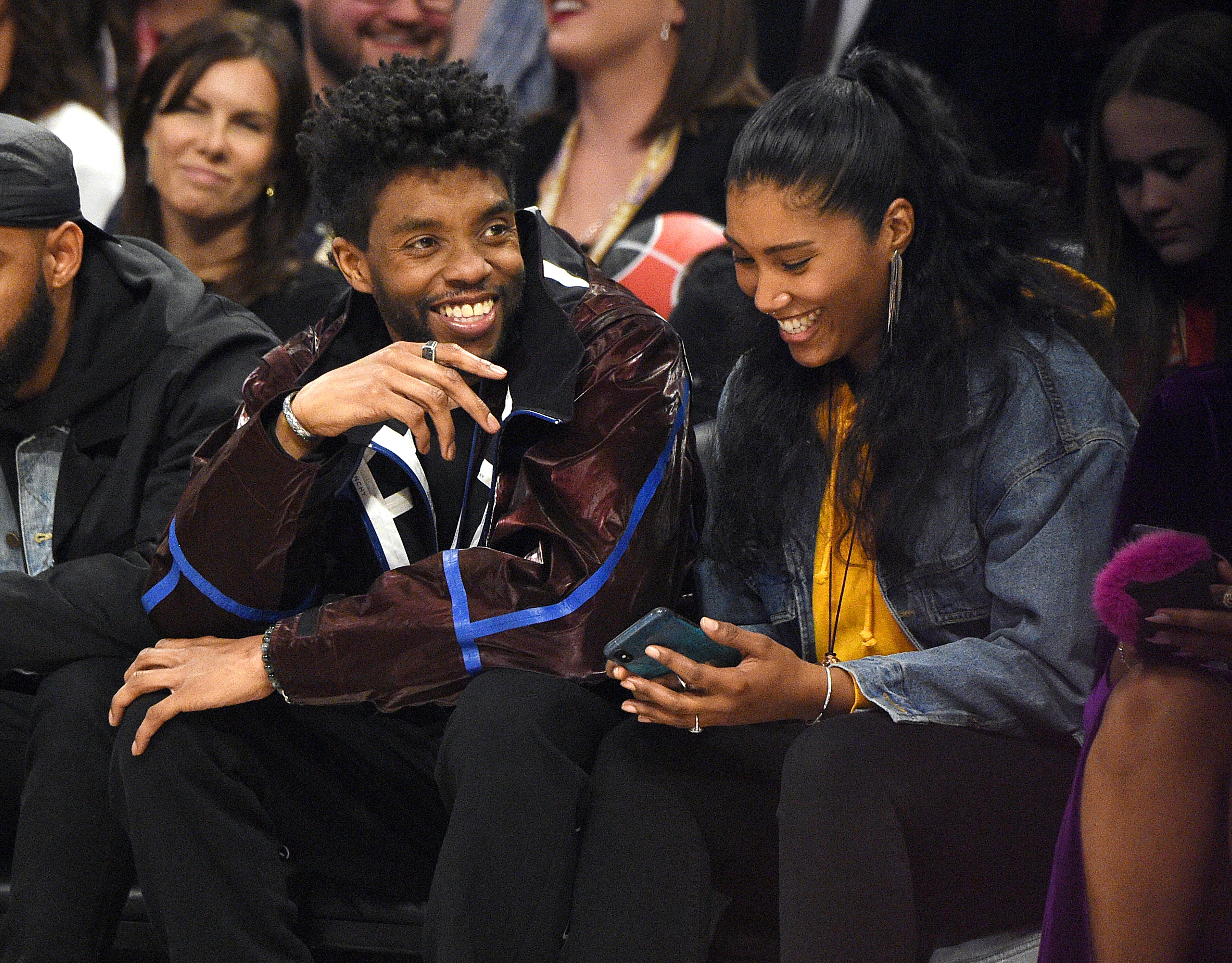 Image Credits: Getty Images / Kevin Mazur | Chadwick Boseman (L) and Taylor Simone Ledward attend the 69th NBA All-Star Game at United Center on February 16, 2020 in Chicago, Illinois.