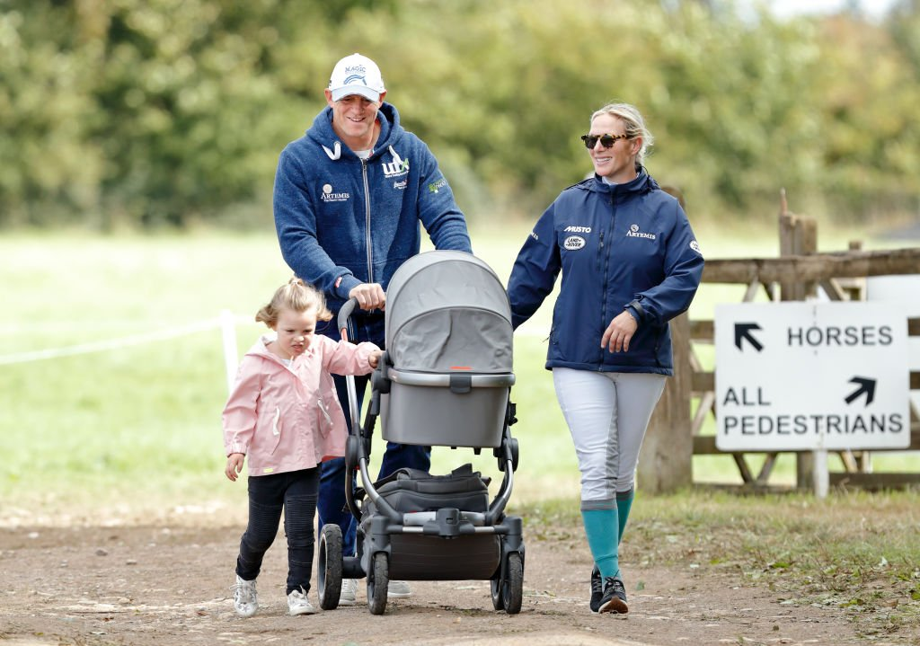 Image Credit: Getty Images / Mike Tindall and Zara Tindall with their daughters Mia Tindall and Lena Tindall (in her pram) at Gatcombe Park on September 9, 2018 in Stroud, England.