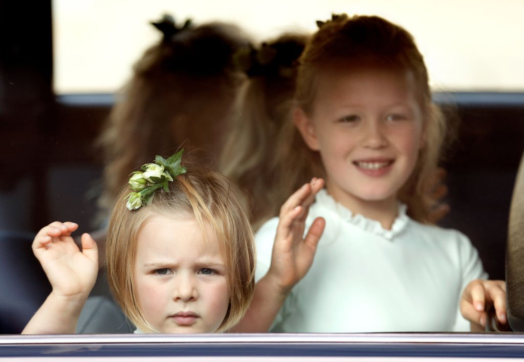 Image Credit: Getty Images / Mia Tindall and Savannah Phillips attend the wedding of Princess Eugenie of York and Jack Brooksbank at St George's Chapel on October 12, 2018 in Windsor, England.