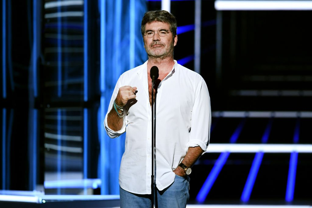 Image Credit: Getty Images / Producer-TV personality Simon Cowell speaks onstage during the 2018 Billboard Music Awards at MGM Grand Garden Arena on May 20, 2018 in Las Vegas, Nevada.